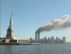 Smoke billowing from New York's Twin Towers following the attack by two airliners on 9/11. Image-National Park Service