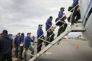 Members of the Type 2 University of Alaska-Fairbanks Nanook Fire Crew board a jet bound for Missoula, Montana on Aug. 11, 2017. Image-BLM