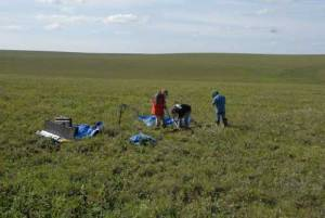 NSIDC scientist Kevin Schaefer (left), and researchers Alessio Gusmeroli and Lin Liu prepare to drill a permafrost core on the North Slope of Alaska near Happy Valley airport. Credit: Tingjun Zhang. High-resolution image
