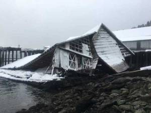 Remaining debris of a collapsed building resulting in an oil spill is shown in Port William, Alaska, March 14. Photo courtesy of Global Diving and Salvage
