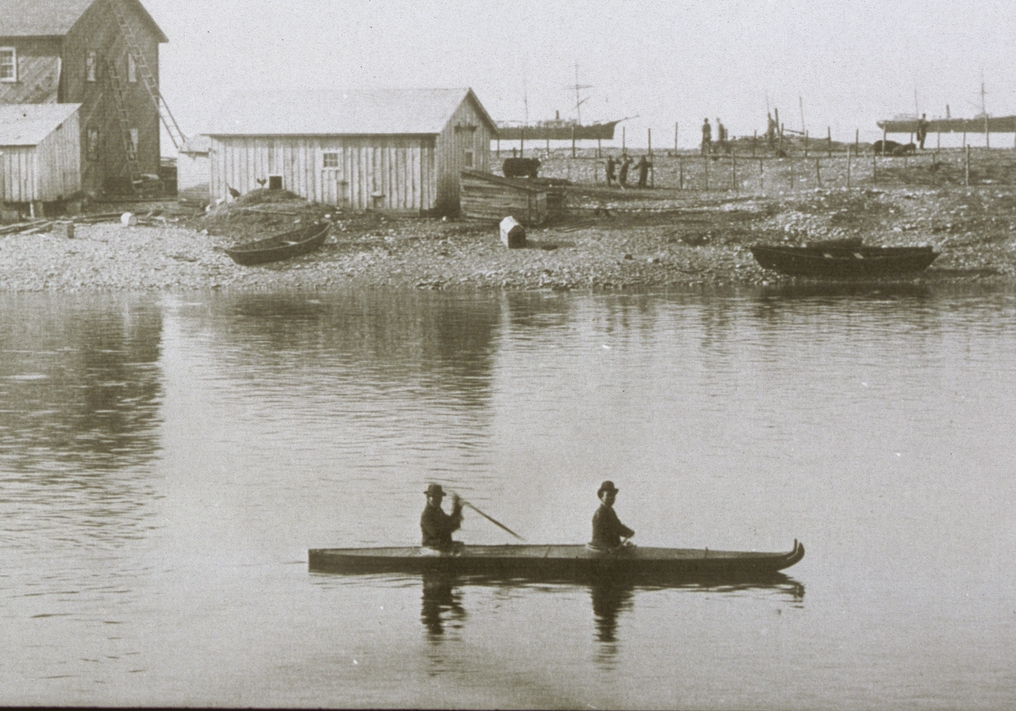 Two men in a two-man version of the Alutiiq kayak in Karluk Lagoon. Image-Alutiiq Museum