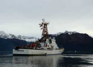 The crew of the Coast Guard Cutter Mustang transits through the calm waters of Resurrection Bay while underway for training near their homeport of Seward. (U.S. Coast Guard photo by Petty Officer 3rd Class Meredith Manning)