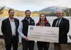 From left: Executive Director of Southeast Conference Robert Venables, VP and Director of Energy Services Alec Mesdag, current scholarship recipient Marina Ogai and Chancellor Rick Caulfield stand by the Auke Lake on the main University of Alaska Southeast campus Friday, Dec 13, 2019 in Juneau, Alaska. (Photo credit: Seanna O'Sullivan)