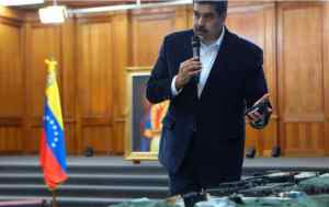This photo released by the Venezuelan Miraflores presidential press office shows President Nicolas Maduro speaking over military equipment that he says was seized during an incursion into Venezuela in Caracas on May 4, 2020.