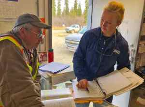 Petty Officer 3rd Class Holly Hugunin, an inspector with Coast Guard Sector Anchorage, works with Kenny Morgan, a Morgan Fuels facility manager in Kalskag, Alaska, May 16, 2019. Hugunin's inspection was part of Sector Anchorage's 2019 Marine Safety Task force initiative. U.S. Coast Guard photo by Lt. Cmdr. David Evans