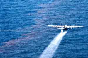 A U.S. Air Force Reserve plane sprays Corexit over the Deepwater Horizon oil spill in the Gulf of Mexico.