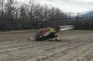 Helicopter wreckage in a field near Palmer, Alaska.