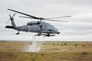 JOINT BASE ELMENDORF-RICHARDSON, Alaska - An HH-60 Pave Hawk helicopter from the 210th Rescue Squadron takes off from the tundra. (U.S. Air National Guard photo by Staff Sgt. Edward Eagerton/released)