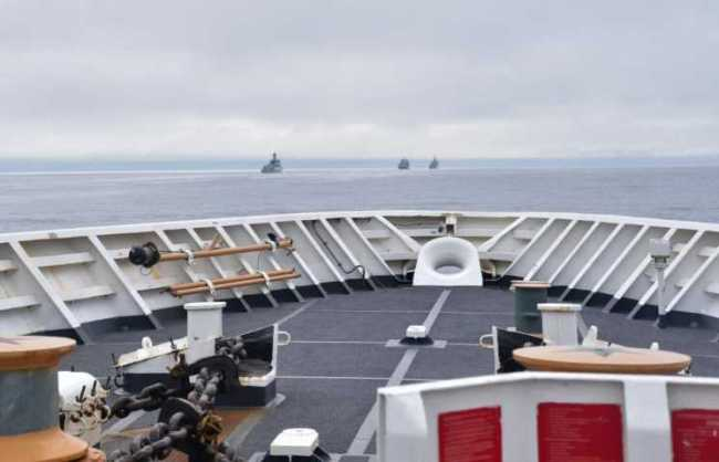 During a routine maritime patrol in the Bering Sea and Arctic region, U.S. Coast Guard Cutter Bertholf spotted and established radio contact with Chinese People's Liberation Army Navy (PLAN) task force in international waters within the U.S. exclusive economic zone, Aug. 30, 2021. All interactions between the U.S. Coast Guard and PLAN were in accordance with international laws and norms. At no point did the PLAN task force enter U.S. territorial waters. U.S. Coast Guard photo by Ensign Bridget Boyle.