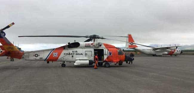 A Coast Guard Air Station Kodiak MH-60 Jayhawk aircrew swaps with another Jayhawk aircrew in Cold Bay, Alaska, to conduct a long-range medevac 190 miles west of Dutch Harbor, Alaska, Aug. 6, 2018. An HC-130 Hercules aircrew assisted by providing a communications platform and transporting the extra Jayhawk aircrew. U.S. Coast Guard photo by Lt. Jeff Mistrick.