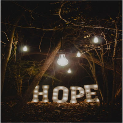 A lit sign spelling the word hope