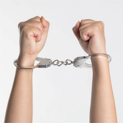 A set of hands in handcuffs