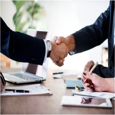 People shaking hands at a business meeting