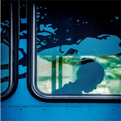 Silhouette of a person in a bus window