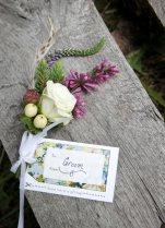Alaska Weddings: Emily & Dan: bountonnières of spray roses, hypericum, foraged hemlock, lilac, veronica and feathers   Flowers by Natasha of Alaskaknitnat.com