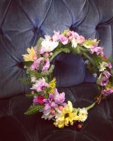 Flower crown made with daisies, button mums, solidago, hypericum berry, mini carnations, wild moss and wild Alaska spruce sprigs   created by Natasha Price of alaskaknitnat.com
