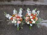A creamsicle wedding   bridal bouquet made with peach roses, football mums, snapdragon, spray roses, lisianthus, limonium, hypericum, safflower and seeded eucalyptus. Designed by Natasha Price of Alaskaknitnat.com