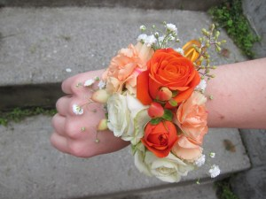 Corsages made with lisianthus, mini carnations, spray roses, hypericum berry , baby's breath and seeded eucalyptus | designed by Natasha Price of alaskaknitnat.com