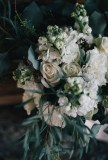 The perfect winter wedding bouquet   roses, stock, waxflower and carnation mixed with eucalytpus. Flowers by Natasha Price and photo by Erica Rose Photography