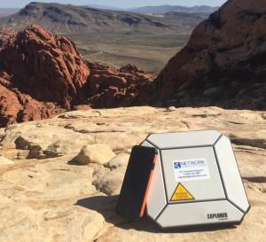 Explorer-510-BGAN-Desert-with-Cell-Phone-300x273.jpg