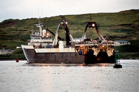 large ocean pollock fishing vessel near shore