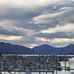 overlooking Kodiak harbor, with mountains and dramatic clouds