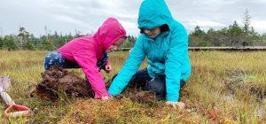 Two girls take water samples