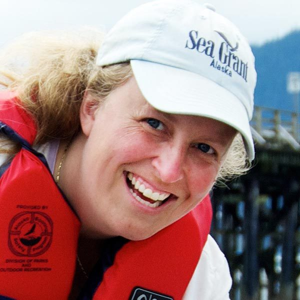 Woman in Alaska Sea Grant hat smiling
