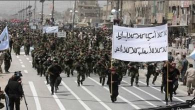 صورة معادلة الفرض بالقوة- بين أمريكا وشيعة العراق