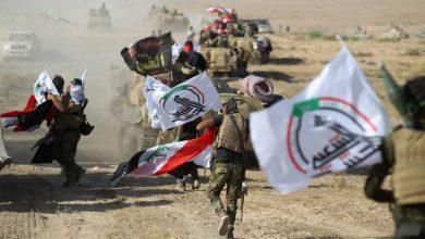 صورة الحشد الشعبي يدافع عن العراق وأمريكا تعتدي عليه..