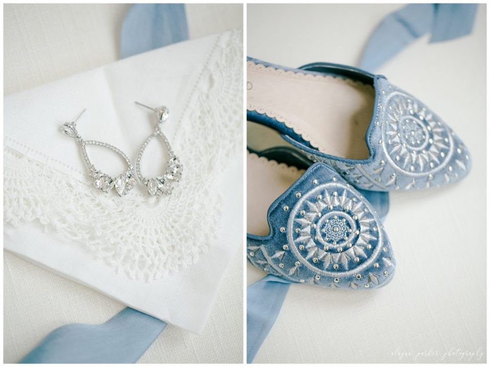 An image of a closeup of a bride's beautiful earrings, and a view of her gorgeous blue shoes for the wedding outfit at Station 67  by Alayna Parker Photography  - Columbus OH wedding photographer