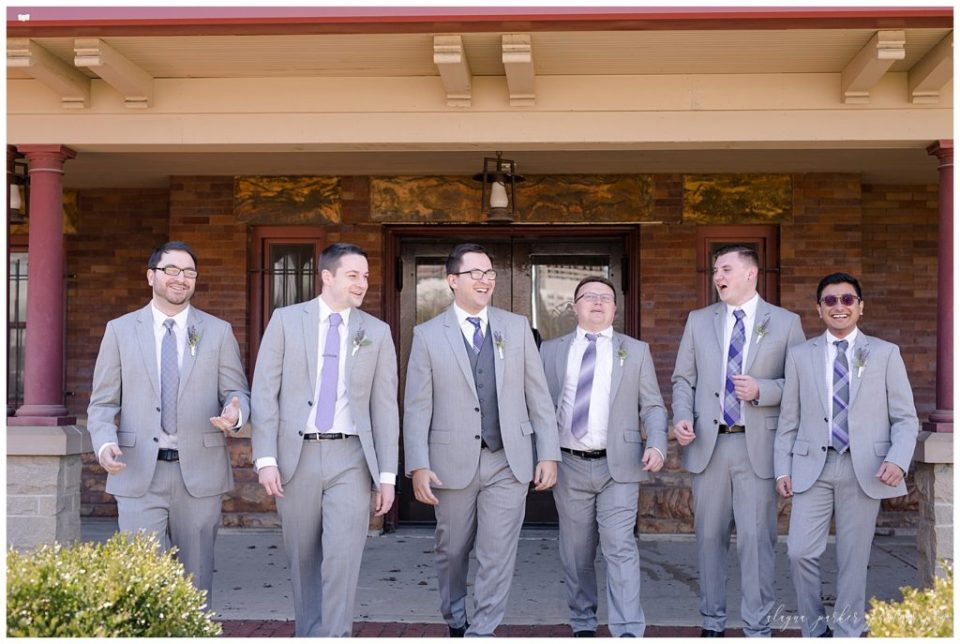 An image of a relaxed groom and his groomsmen lined up and laughing before the wedding ceremony at Station 67 on W Broad St in Columbus by Alayna Parker  - Columbus OH wedding photographer