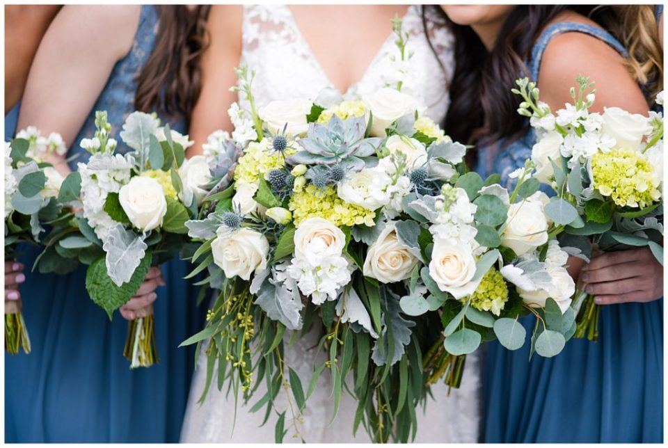 A picture of a closeup of the bouquets of the bride and bridesmaids held together at a Buckeye Barn wedding by Alayna Parker  - Columbus  wedding photos