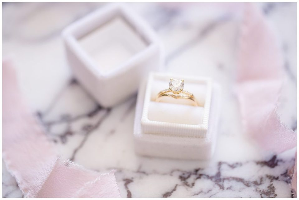 diamond solitaire wedding ring and matching band in white velvet ring box