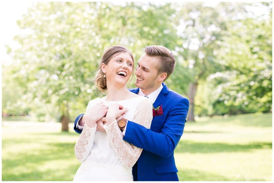 A picture of the bride and groom laughing together as they hold each other close at Dock 580, in the hostoric Smith Bros Hardware building by Alayna Parker  - Columbus  wedding photos