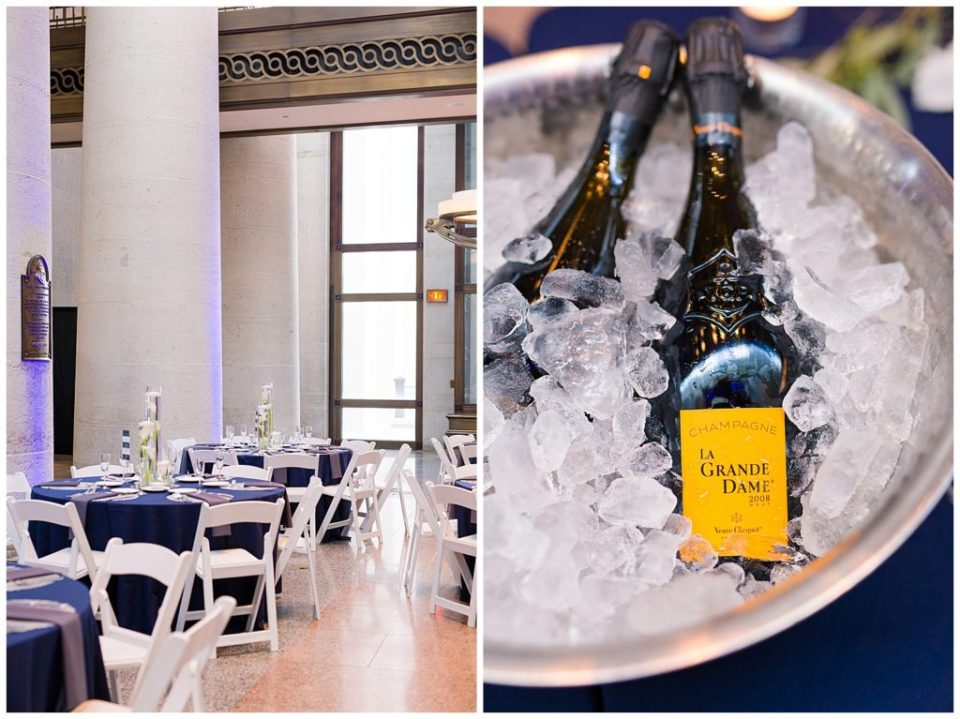 An image of several tables arranged and ready for guests at a wedding reception, and a view of champagne bottles on ice, waiting to be served to reception guests at the Ohio Statehouse by Alayna Parker  - Columbus Ohio wedding photography