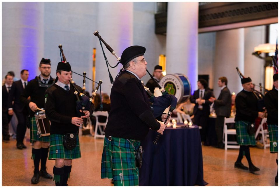 A picture of a Scottish bagpipe group performing at a wedding reception in their kilts at the Ohio Statehouse by Alayna Parker  - Columbus  wedding photography
