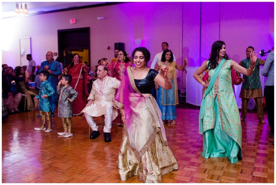 An image of guests enjoying the dancing at a Hindu party after the engagement ceremony at the Bertram Inn and Conference Center in Aurora by Alayna Parker Photography  - Cleveland Ohio engagement photographer
