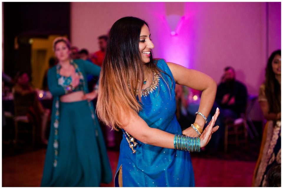 A photograph of a beautiful Indian guest dancing at the party after a Hindu engagement ceremony at the Bertram Inn wedding venue by Alayna Parker Photography  - Akron OH engagement photography