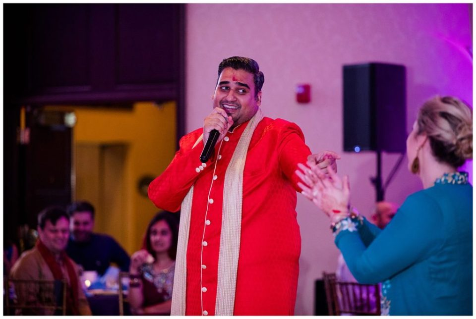 A photograph of a singer performing at an Indian engagement party at the Bertram Inn and Conference Center in Aurora by Alayna Parker Photography  - Cleveland OH engagement photography