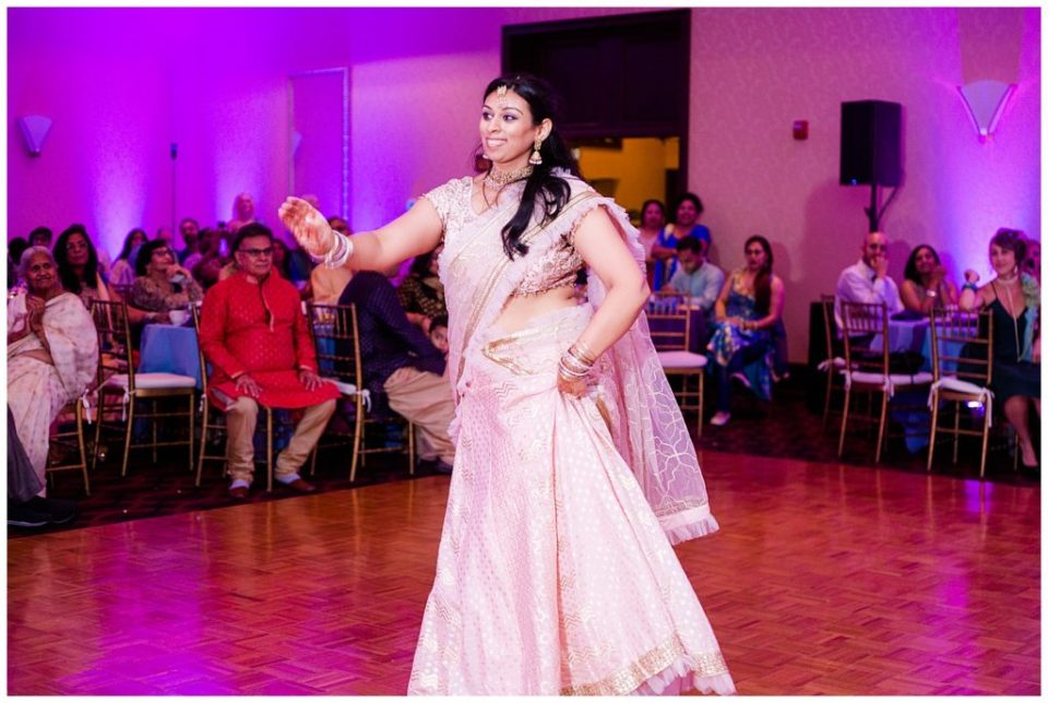A picture of an Indian dancer performing at a Hindu engagement celebration at the Bertram Inn wedding venue by Alayna Parker Photography  - Akron  engagement photographers