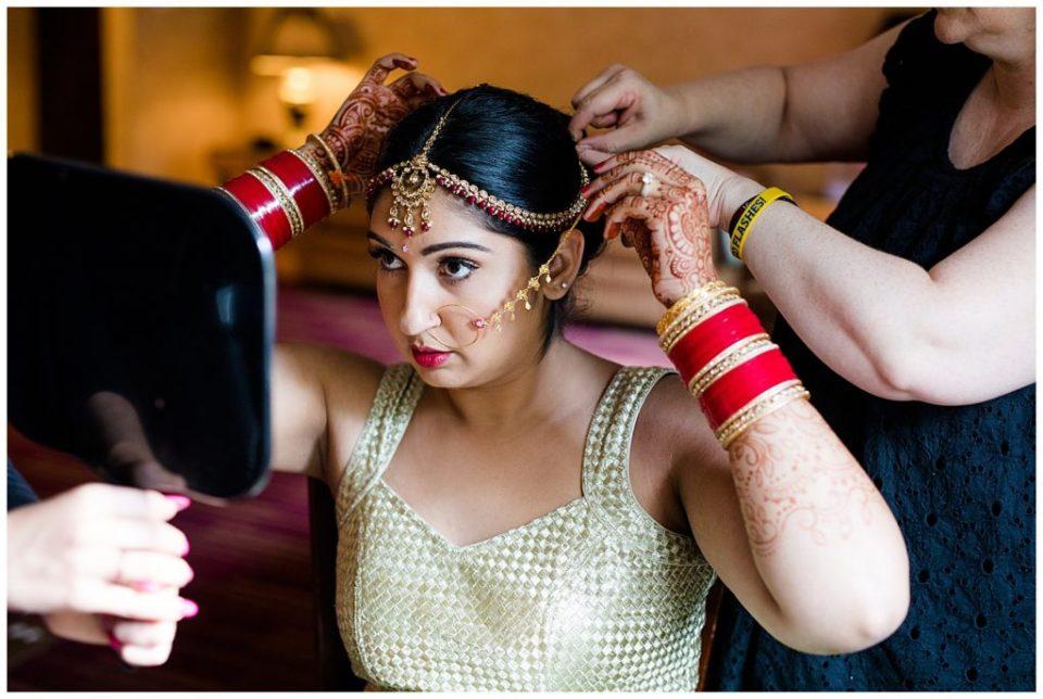 bride putting in nose ring