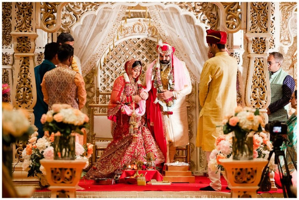 An image of the Indian bride and groom standing in prayer during their Hindu wedding at the Bertram Inn wedding venue in Aurora, Ohio by Alayna Parker  - Cleveland Ohio wedding photographers