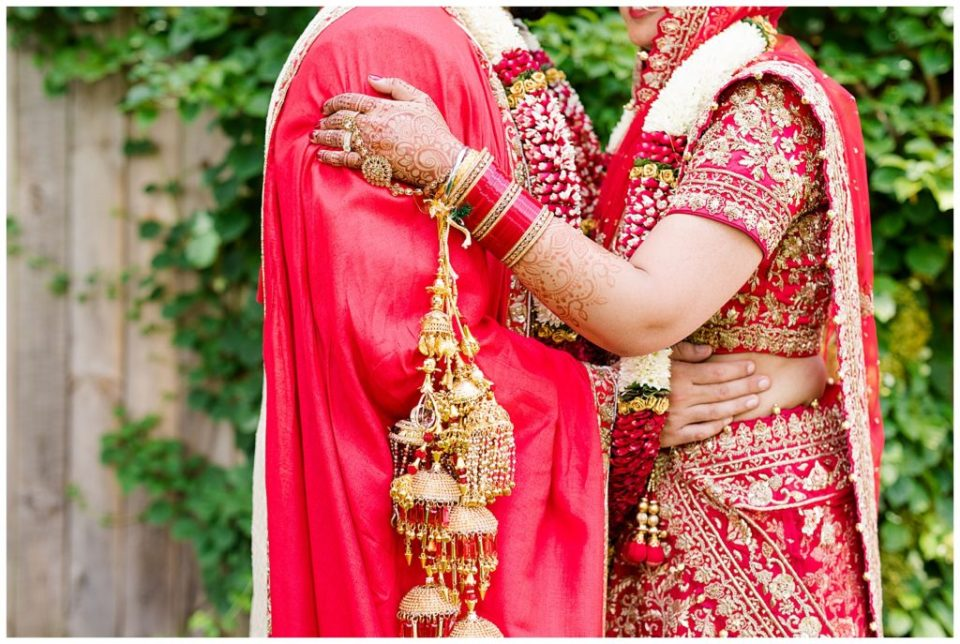 A picture of a closeup view of an Indian bride and groom with the bride's rings, special jewelry and henna tattoos after their wedding in Chagrin Falls by Alayna Parker Photography  - Akron  hindu wedding photography