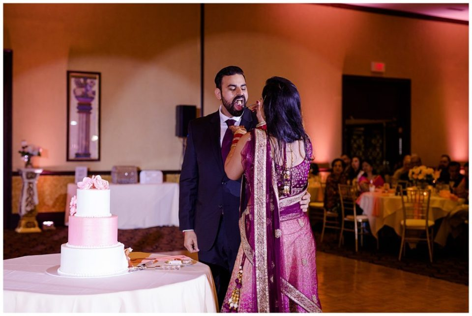 bride feeding groom cake at bertram inn