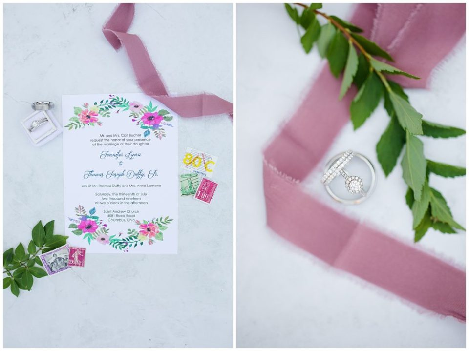 wedding invitation and vintage stamps on marble background