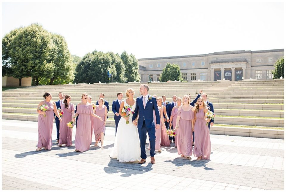 bridal party walking in front of steps at cosi