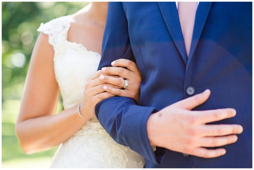close up of bride's hands holding onto groom