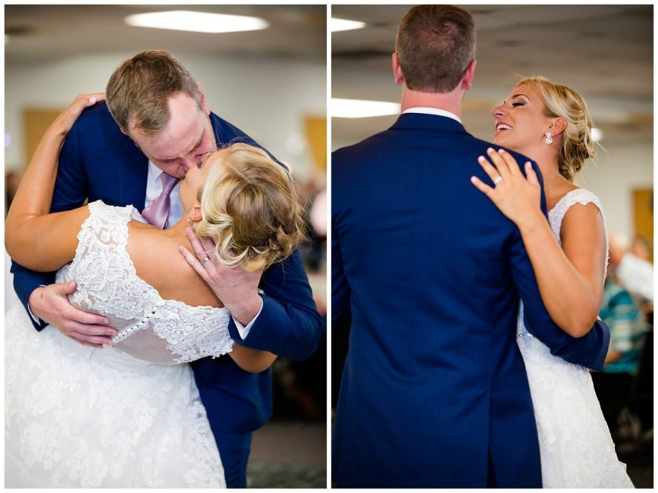 groom dips bride and kisses her during first dance