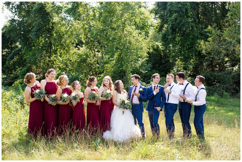 bridal party laughing in field at cedar grove lodge